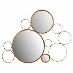"Iron-framed wall mirror with a circles design and antique gold finish.  Product: MirrorConstruction Material: Iron and mirrored glassColor: Antique goldDimensions: 44"" H x 53"" W x 1"" D"