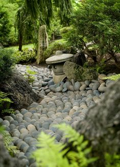 "Here, tumbled gray river rocks of uniform size have been carefully arranged in this meandering dry streambed to create the illusion of flowing water. Ferns and evergreens line the stream, softening its ""shoreline. Garden Rake, Diy Garden, Dream Garden, Shade Garden, Garden Landscaping, Zen Rock Garden, Buddha Garden, Japanese Garden Landscape, Small Japanese Garden"