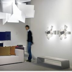 big bang wall lamp composed by overlapping planes in white or red a