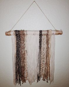 Handmade Yarn Wall Hanging by EliaCo on Etsy https://www.etsy.com/listing/271118806/handmade-yarn-wall-hanging tapestry strings fit cute neutral nursery boho minimalist style trendy hipster black white beige distressed wood twine home decor wall art anthropologie knock off cheap