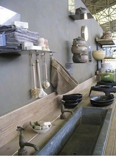 Outdoor utility sink in Netherlands, Gardenista Love the grey with natural tones.
