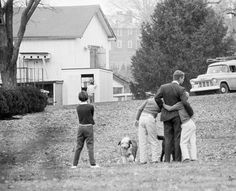 Robert Kennedy is comforted by his children after he had been notified of the assassination of his brother, 1963