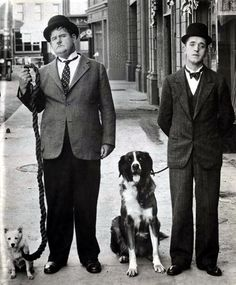 Stan Laurel, Oliver Hardy and Dogs ca.1930's photographer unknown.