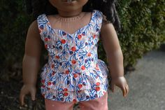 Peach blooms ruffle peplum top by camelotstreasures on Etsy. Made using the LJC Peplum Top pattern, found at http://www.pixiefaire.com/products/peplum-top-18-doll-clothes. #pixiefaire #libertyjane #peplumtop