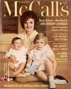 """Front cover of McCall's magazine dated May 1962 featuring First Lady Jacqueline Kennedy with her children. Caroline Kennedy and John F. Kennedy Jr. are seated on Mrs. Kennedy's lap. """"Children in the White House from Tyler to Kennedy."""""""