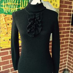 Black Turtle neck sweater from Talbots Beautiful turtle neck  sweater with cute ruffle design from Talbots. Perfect to pair it with blazer for chic look in your office or just a lunch date in any cold day. Used it few times. In excellent used condition. Note: please ask any questions before purchasing or making any offers.  I want my customer to be satisfied and happy with their purchases.Thank you. Talbots Sweaters Cowl & Turtlenecks
