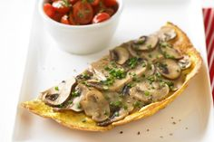 Each type of mushroom brings its own flavour and texture to this hearty vegetarian omelette.