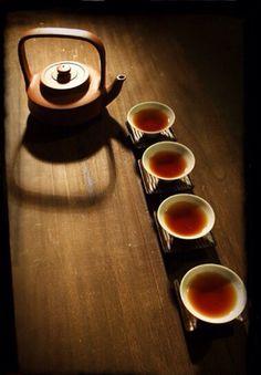 Beautiful tea cups. Love the vibrant color of the tea.