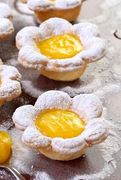 Flower Shaped Mini Lemon Tarts - A bite sized dessert pretty enough for any special occasion. From Easter to Mother's Day, birthdays to bridal showers, sure to impress.