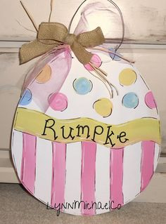 Hey, I found this really awesome Etsy listing at http://www.etsy.com/listing/174239169/easter-egg-door-hanger-personalized