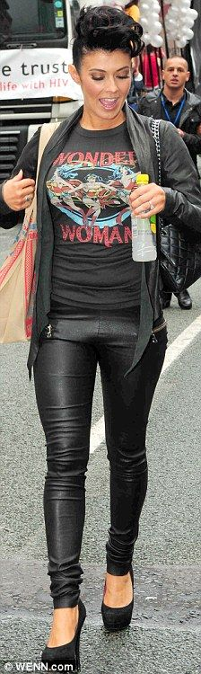 Rock chick: Kym looked trendy in her skintight leather trousers and Wonder Woman T-shirt