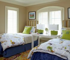 Plum Interiors by Kartra Designs: Fun boys' bedroom with cafe au lait walls paint color and arch window with plantation ...