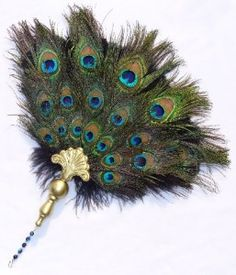 Elizabethan feather fan. Oooh, I'm making one...how fun and beautiful!!