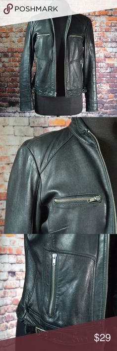 """Mossimo Black Leather Biker Jacket Buttery soft leather. Flawed elbows give this jacket a biker, sexy, """"James Dean"""" once wore this appeal.   Brand: Mossimo Size: Medium Color: Black Bust: 38"""" Length: 23.5"""" Fabric: Genuine Leather, polyester lining Imported Well Used Condition, flawed  Reasonable Offers Welcome! Bundle and Save on Shipping!  Disclaimer: This jacket was sourced from a neighbors garage sale; they were smokers. Jacket has been treated, but still has a smoky """"just left the bar""""…"""
