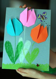 We made a little art project with some super-simple origami tulips. With only a few folds, this is a great origami project for anyone! Spring Art Projects, Spring Crafts, Projects For Kids, Preschool Crafts, Crafts For Kids, Arts And Crafts, Paper Crafts, Tulip Origami, Origami Easy