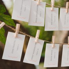 Clothes Pin Escort Card Display // photo: Jeff Loves Jessica Photogrpahy // Escort Cards: Ginger P Designs // http://www.theknot.com/weddings/album/a-rustic-romantic-wedding-in-stillwater-mn-132453