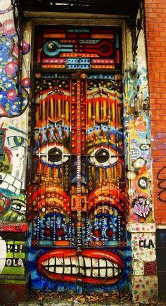 Painted doors in Buenos Aires, Argentina. Cool Doors, Unique Doors, Knobs And Knockers, Door Knobs, Gates, Porte Cochere, When One Door Closes, Door Gate, Grand Entrance