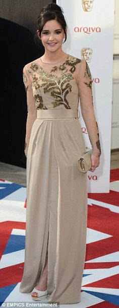 Eeek! Is that me? EastEnders star Jacqueline Jossa looked a far cry from her character Lauren as she arrived at the awards in a very elegant beige and chiffon creation