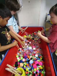 Simple Sensory Table Idea, perfect for Chinese New Year: Pom Poms & Chopsticks Gross Motor Activities, Gross Motor Skills, Sensory Activities, Activities For Kids, Indoor Activities, Physical Activities, Sensory Table, Sensory Bins, Sensory Play