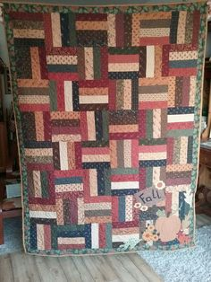 Finally Fall quilt made of Kansas Troubles fabrics Cattails and clover