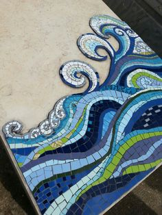 Sea waves on my father's gravestone. Made with ceramic tiles by MargalitMosaic.