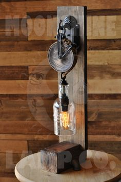 Steampunk Desk Lamp – The Chandler – Recycled Glass Bottle and Pulley Wheel Wooden Desk Lamp – Top Trend – Decor – Life Style Wooden Desk Lamp, Steampunk Desk, Pulley Light, Diy Lampe, Deco Luminaire, Recycled Glass Bottles, Pipe Lamp, Pipe Desk, Pipe Table
