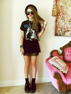 Cool punky style. (I like the couch too!)