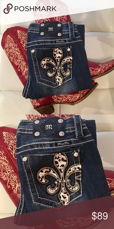 """Feisty Cheetah Miss Me Skinnies Fierce & Fabulous Cheetah Midrise Miss Me SkinniesPony Hair Inlayed Fleur de Liz are Accented with Studs and Bling in the HOT HOT HOT Miss Me Skinnies!  The detailing REALLY POPS against gorrrrrgeous dark wash denim.  Hard to let these beauties go! You will catch everyone's eye as these transform you into a walking piece of delicious artwork❣Rise 8"""" Inseam 31"""" Miss Me Jeans Skinny"""