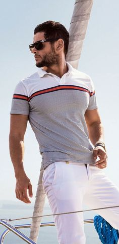 Men's casual summer fashion style 2017. Polo shirt and white chinos yacht preppy style outfit.