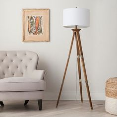 A unique tripod lamp to illuminate your space.   31 Home Decor Products You Didn't Know You Could Get At Target