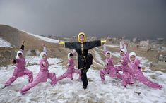 Massoud Hossaini/AP Photos  Afghan members of a wushu martial arts group led by trainer Sima Azimi, 20, pose for a photograph at the Shahrak Haji Nabi hilltop overlooking Kabul. Afghanistan's first female wushu trainer, Sima Azimi, 20, is training 20 Afghan girls aged between 14 – 20 at a wushu cl