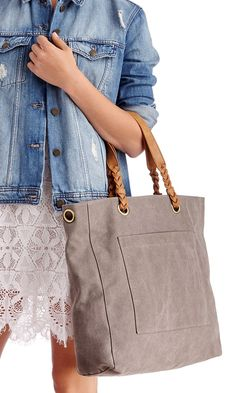 Grey canvas tote bag with braided shoulder straps