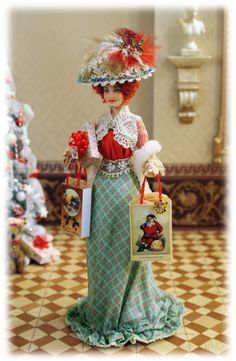 1900_12. This fashionable lady by Elisa Fenoglio has already started her Christmas shopping.