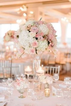 Wedding reception classic decor tall pink and white flower arrangement rose hydrangea gold candles #classicweddingdecorations