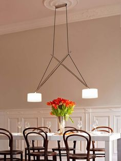 TWIN by serien.lighting. Perfect fit for a generous sized dinner table.