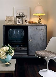 By using an old cabinet to hide a tv, the room can be used as both a hangout and a nice spot to entertain.