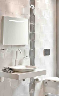 Like the ripple tiles with the wall hung vanity basin. #Decorative #Tiles #vanity #basin