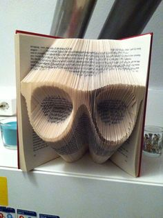 Book folding pattern for a pair of glasses by BookFoldingForever