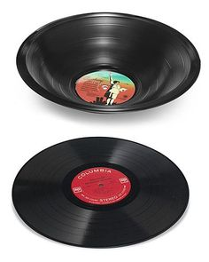 """melted record bowlTO DO: Take record, place in oven that is at 150F (on a glass or metal bowl)..watch for the 15 secs it takes to """"flop""""...remove from oven, quickly """"mold"""" into into the shape you want. Voila...SAVE $50 from this site!! I made 80 of these as centerpieces for my wedding...cost me NOTHING!"""