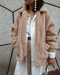 That teddy coat and those earrings❤️