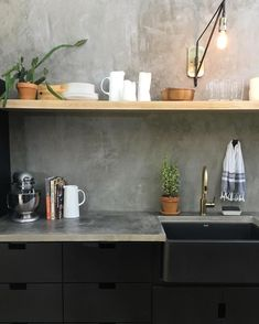 I like the look of concrete countertops annnnd concrete walls now too! …