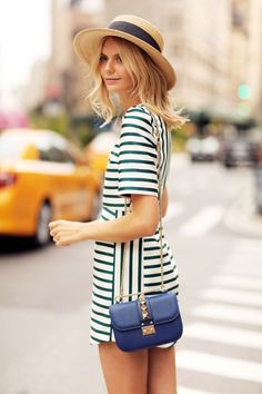 Shop this look on Lookastic:  https://lookastic.com/women/looks/white-and-green-horizontal-striped-shift-dress-blue-leather-crossbody-bag-beige-straw-hat/11277  — Beige Straw Hat  — White and Green Horizontal Striped Shift Dress  — Blue Leather Crossbody Bag