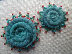 Felted spiral brooches......oh, could see pieced piping, coiled fabric braids, such a cool playtime.