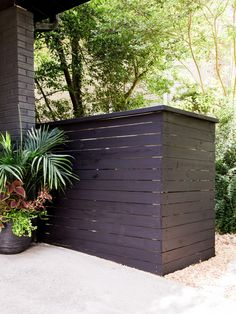 Hide your unsightly trash can with a stylish wood screen.