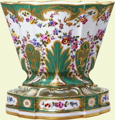 Vase hollandois  The vase hollandois was designed for growing plants or bulbs. Porcelain flowers were sometimes substituted for living plants in the vase hollandois.    Sèvres porcelain factory   circa 1757  Soft paste porcelain, green and white ground and gilded decoration  Royal Collection ©