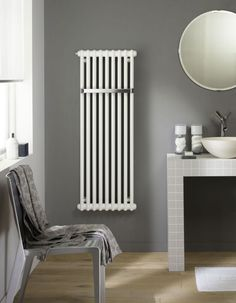 A classic radiator but with the bonus of a towel rail meaning a decent heat output unlike many ladder style heated towel rails or chrome radiators. Vertical Radiators, Column Radiators, Traditional Radiators, Chrome Towel Rail, Bathroom Towel Rails, Towel Hooks, Bathrooms Online, Bathroom Radiators, Towel Radiator