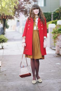 red pea coat + mustard layers + blouse sleeves peeking out. love.