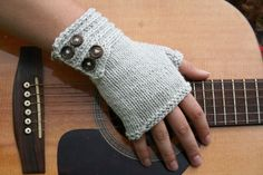 Simply beautiful.These fingerless mitts are knit with only one ball of yarn. The band is knit first and stitches are picked up to knit the mitt.