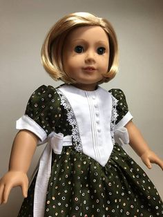 Christmas dress is a delicate look of heirloom and princess combined. The dress is made of a high quality cotton print that just screams Christmas with its colorful dots on hunter green. The bodice has an overlay that is heirloom stitched with several lines of pin tucking that end at