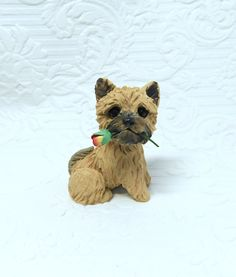 Cairn Terrier lover Gift, Cairn Terrier art, Cairn Sculpture Polymer Clay with Rose Mini by Raquel at theWRC clay DOG Collectible. Cairn Terrier lover Gift, Cairn Terrier art, Cairn Sculpture Polymer Clay with Rose Mini by Raquel at theWRC clay DOG Collectible This little pup looks so cute holding a a rose in it's mouth for someone special! Hand sculpted polymer clay dog. Made with love and care! Measures approx. 2.25 inches tall.
